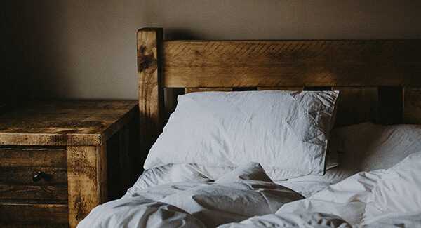 A bed ready for someone to sleep in for he night